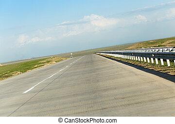 new asphalt road on nature