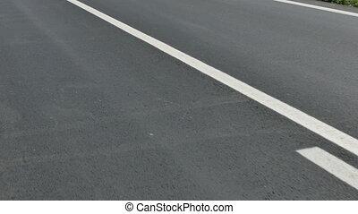 New asphalt road - Lines at asphalt road, footage from...