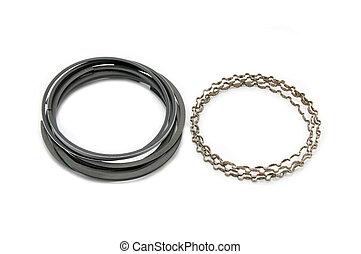 New Auto piston rings on a white background