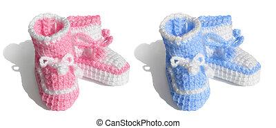 New baby, girl or boy. Tiny bootees - Girl, boy. Newborn ...