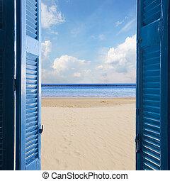 new beginings concept - open blue door to sandy beach and...