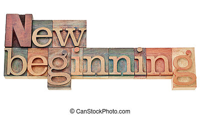new beginning - isolated text in vintage wood letterpress printing blocks stained by color inks