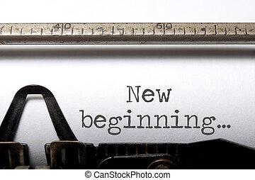 New beginning printed on an old typewriter