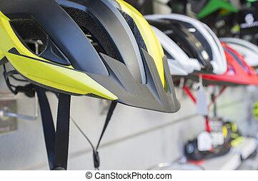 New bike helmets displayed on shop