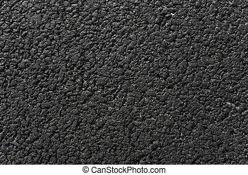 New black asphalt background texture on a new road.