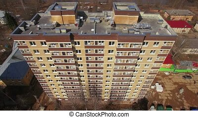 Aerial shot of new highrise apartment block with following view to the community with private houses, Russia