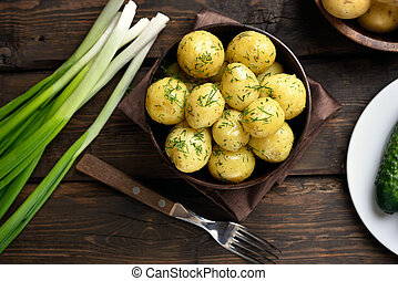 New boiled potatoes with dill, top view