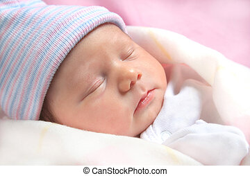 New Born - Adorable sleeping new born baby all bundled up in...