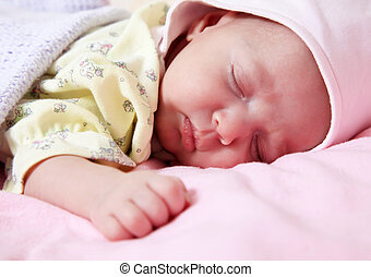 New born baby girl peacefully sleeping