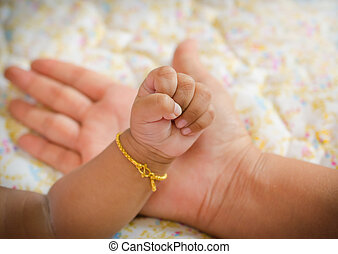 New born baby hand in mom's palm