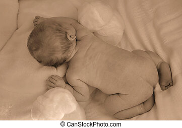 New born baby naked on a blanket