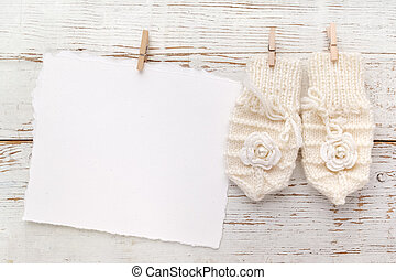 New Born or baptism Greeting Card. Blank with baby girl gloves on white wooden background