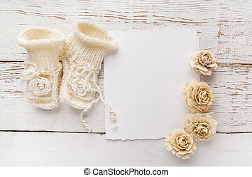 New Born or baptism Greeting Card. Blank with baby girl shoes and gloves on white wooden background