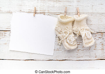 New Born or baptism Greeting Card. Blank with baby girl shoes on white wooden background
