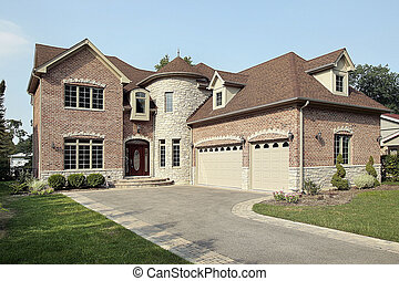 Brick new construction home with large turret