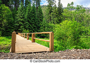 new bridge from road to forest. horizontal - new wooden...