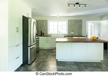 New bright kitchen with marble tiles
