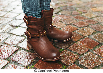 New brown leather boots on child's feet