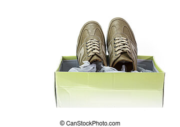 New brown shoe in box isolated on white background