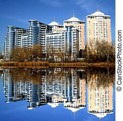 New building with reflection in lake in Kiev, Ukraine