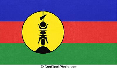 New Caledonia island national fabric flag, textile background. Symbol of world oceania country.