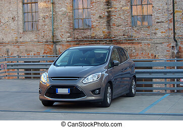 new car in degraded environment - a new car parked in an old...