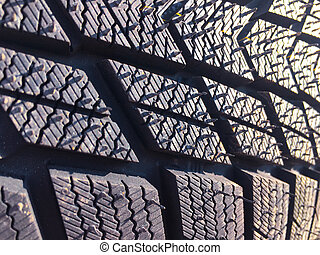 New car tire texture at the garage background