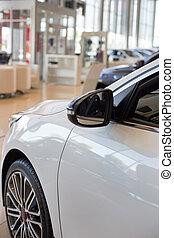 New cars at dealer showroom. Car auto dealership.