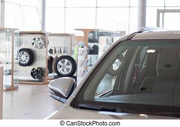 New cars at dealer showroom.
