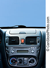 console - New cars console on the blue sky background