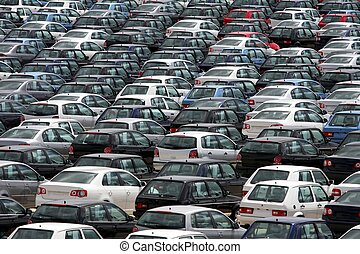 New Cars - Brand new motor vehicles in a parking lot waiting...
