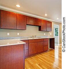 New cherry wood cabinet kitchen.