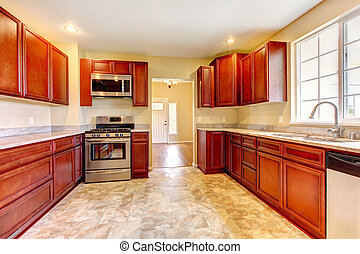 New cherry wood kitchen with stinless steal appliances.