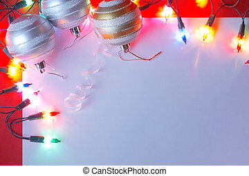 New Christmas baubles border with holiday lights.