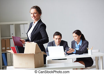 New co-worker - Portrait of smart businesswoman with box ...