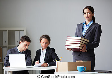 New co-worker - Portrait of smart businesswoman with stack ...
