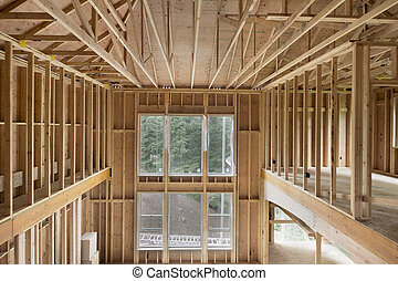 New Construction Home Two-Storey High Ceiling Family Room Wood Stud Framing with Windows