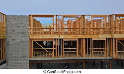 New construction of beam construction house framed the ground up framing against a blue sky