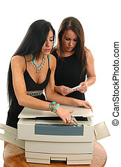 New Copier - Two women trying to figure out how to work the...