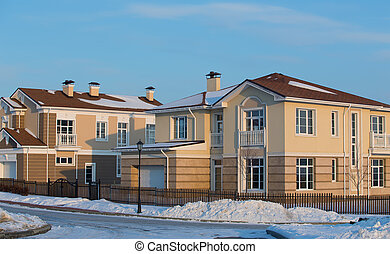 New cottages in the snow in the winter