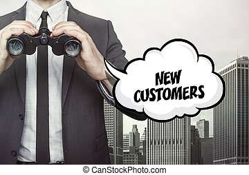 New customers text on speech bubble with businessman holding binoculars