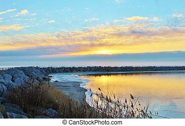 New Day Dawns - Sunrise over Lake Huron Harbor. Lexington...