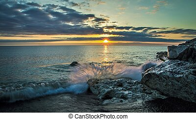 New Day Dawns - Wave crashes over the rocky Lake Huron...