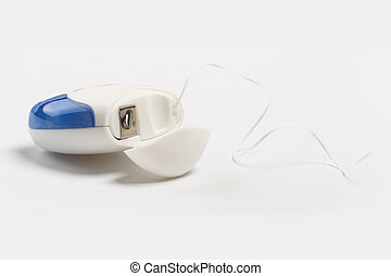 New dental floss isolated on a white background.