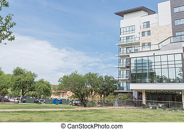 New development apartment building with large grass lawn