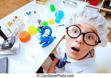 new discovery - A boy is studying in the laboratory. He is...