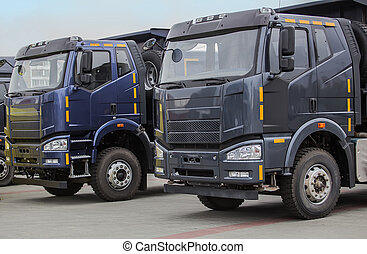 New dump trucks in a row