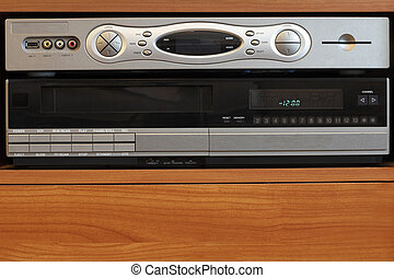 Technology to watch television in modern ways sits on top of an old video player.