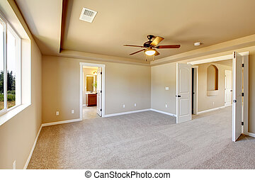 New empty room with beige carpet.. New house development in...