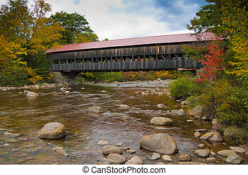New England covered bridge during the fall season
